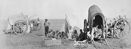 Camp scene of Métis people with carts on the prairie, 1872-1873